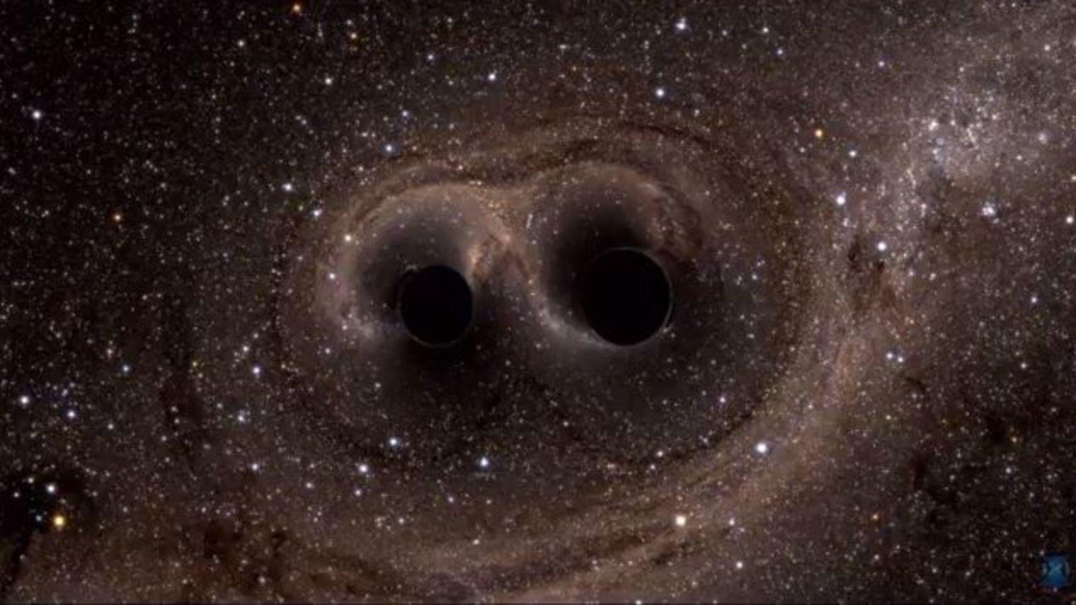 Simulation de la fusion de trous noirs © LIGO